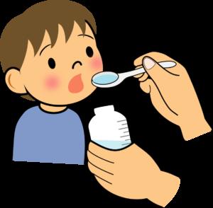 薬を飲む子供